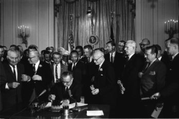 LBJ signs the Civil Rights Act of 1964